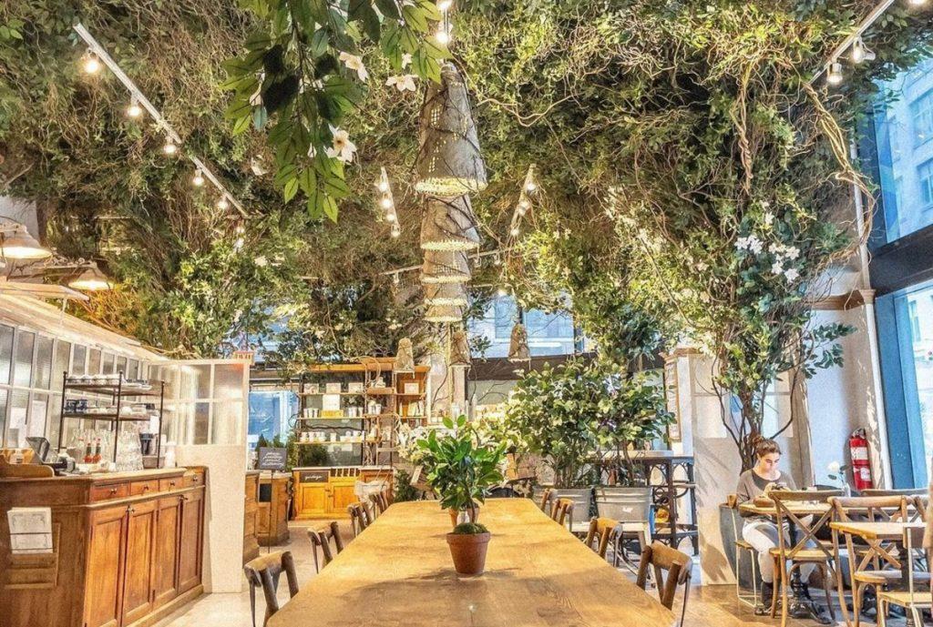 Beloved NYC French Café Maman's Newest Location Is A Green Garden Wonderland