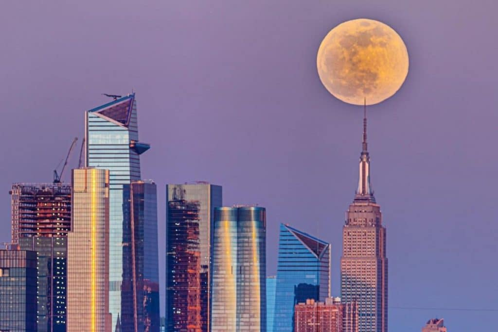 10 Stunning Photos Of The Pink Supermoon Rising Over NYC This Week