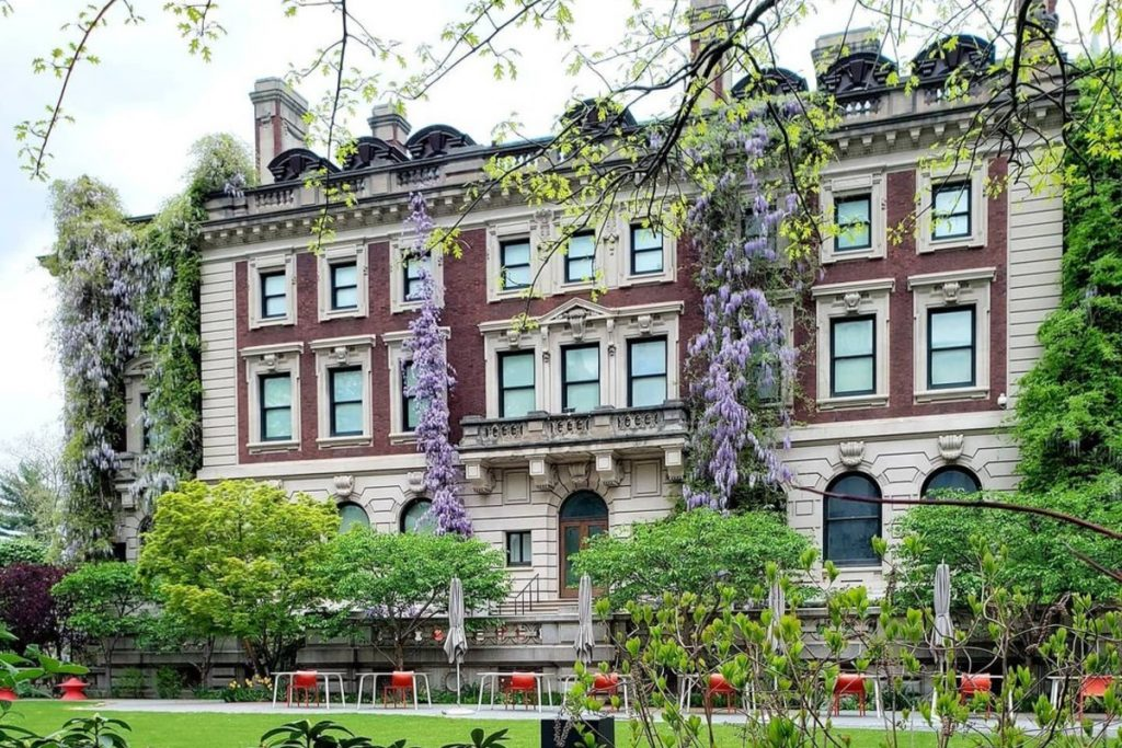 This Hidden Mansion Garden In NYC Is Gorgeously Draped In Wisteria Vines