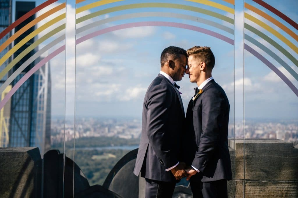 5 LGBTQ+ Couples Were Treated To The Dreamiest Weddings At Rockefeller Center This Weekend