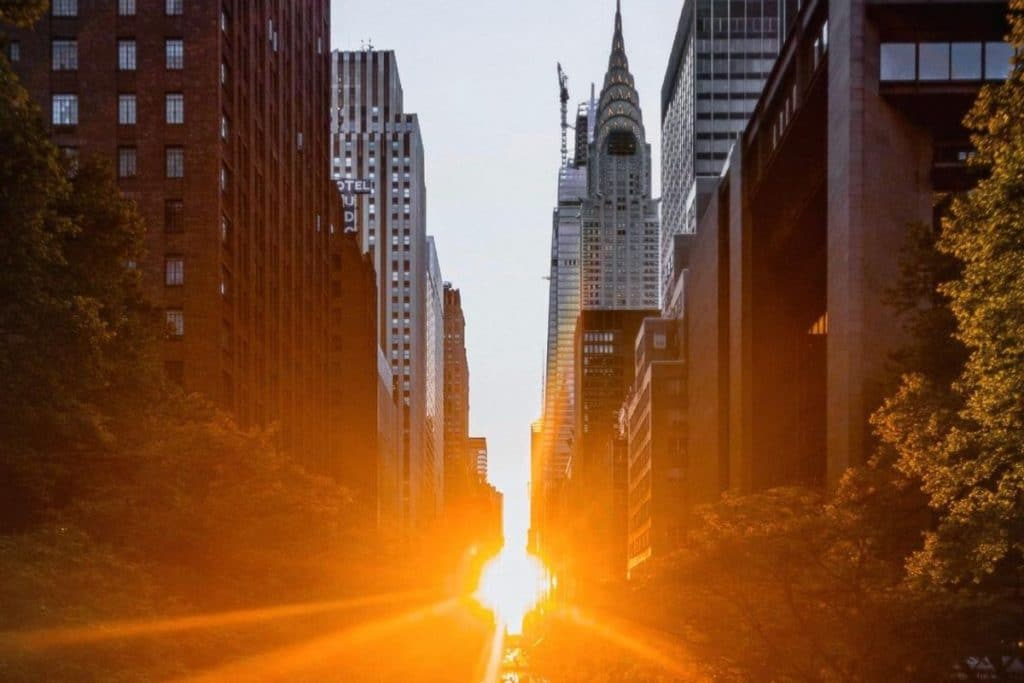 10 Stunning Photos Of The Year's First Manhattanhenge Illuminating The Streets Of NYC